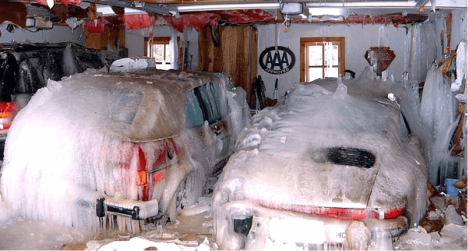 cars in a garge frozen with a solid sheet of ice