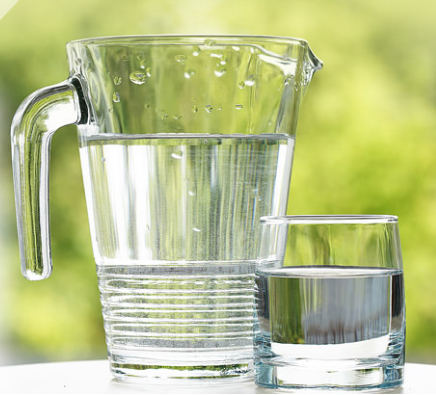 A pitcher and glass of filtered drinking water